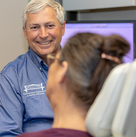 Dr Charles Felts consulting a patient about implants Chattanooga TN