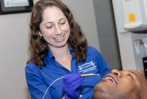 Dr Elizabeth Felts Randal performing dental laser treatment on a patient Dr Felts and his daughter Dr Felts Randall Chattanooga TN
